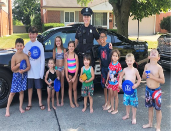 Livonia Police Officer with kids